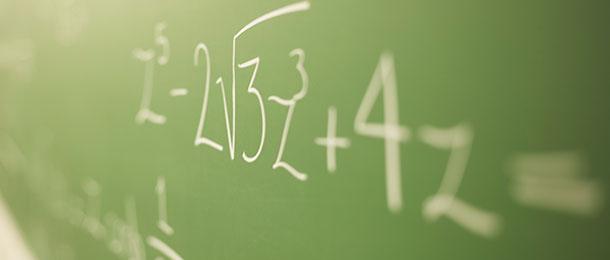Calculations written on chalkboard