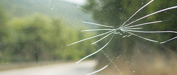 A window with cracks appearing in it.