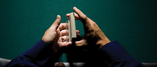 Close-up of hands shuffling a pack of cards