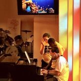 Bruce teaching one of the VBS kids how to play the piano.