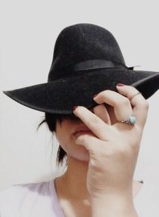 I'm wearing a black fedora from Aritzia.