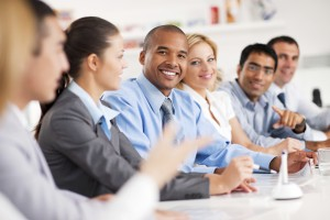 Large group of business people sitting in a row and communicating.  The focus is on African-American looking at the camera.  [url=http://www.istockphoto.com/search/lightbox/9786622][img]http://img543.imageshack.us/img543/9562/business.jpg[/img][/url] [url=http://www.istockphoto.com/search/lightbox/9786738][img]http://img830.imageshack.us/img830/1561/groupsk.jpg[/img][/url]
