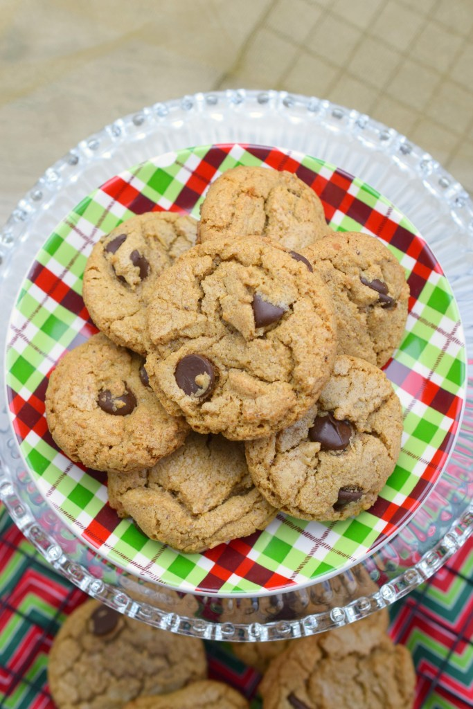 overhead shot of cookies on plate over wire rack and holiday fabric