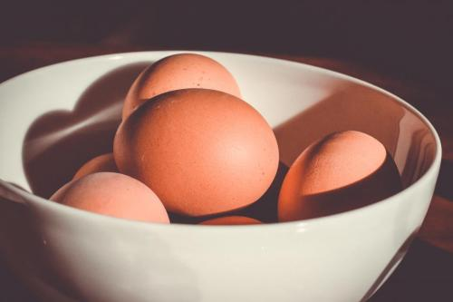 food, cook, eggs, stack, pile, bowl, light, shadows, still