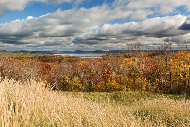The Glen Lakes sit ensconced with the perfect wrappers of trailing clouds, dune grass, and fall colors - as seen from the Sleeping Bear Dunes