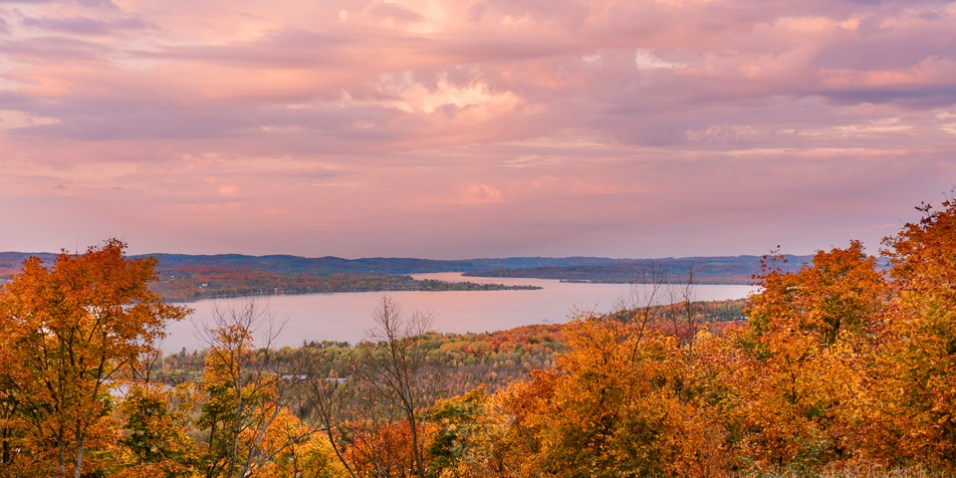 Fall colors surround this gorgeous sunset overlook of the Lake Leelanau Narrows