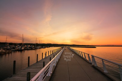 Photo: A vibrant orange sunset shines above the pier in Traverse City's Clinch Marina