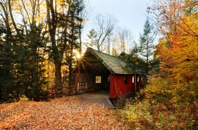 Photo: red covered bridge, fall, Lake Ann, Michigan