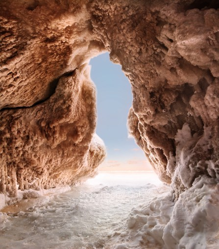 Photo: inside an ice cave on Lake Michigan at dawn