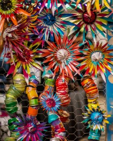 A detailed closeup of Autumn Pearson's colorful upcycled folk art