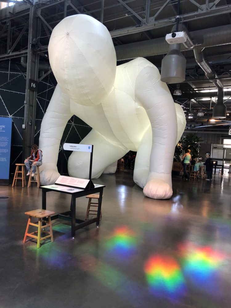 Inflated Man with rainbow on floor