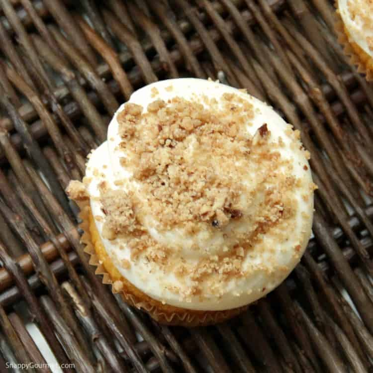Pumpkin Ale Cupcakes - top of cupcake loaded with cream cheese frosting and homemade streusel topping