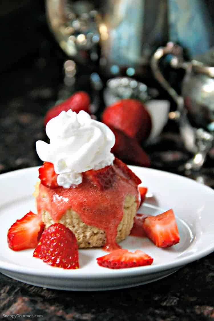 almond flour muffin with strawberry sauce and whipped cream