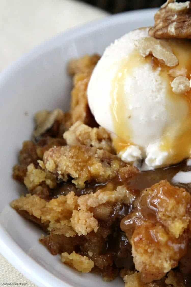 Caramel Apple Dump Cake in bowl with ice cream
