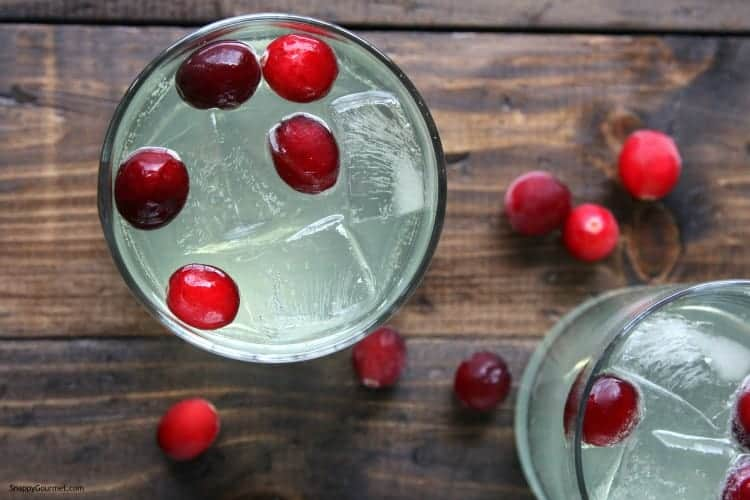 overview of limoncello drink with cranberries and ice
