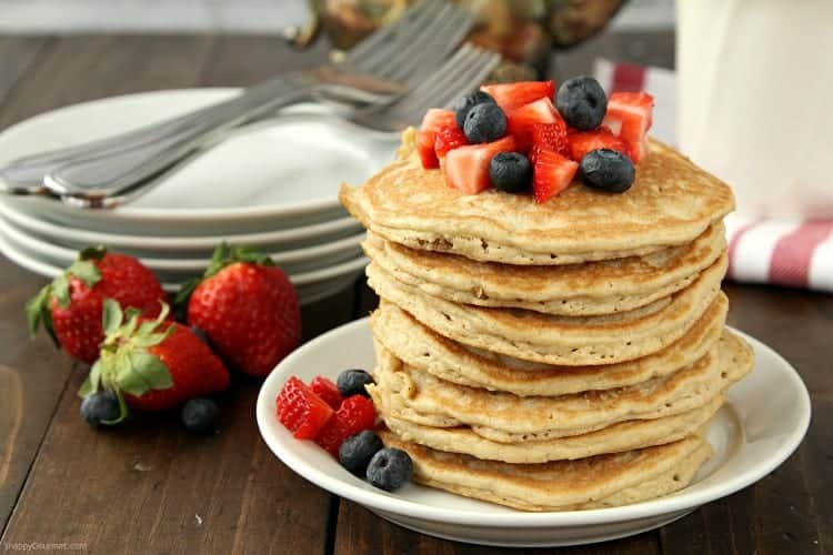 light and fluffy almond flour pancakes on plate with fruit