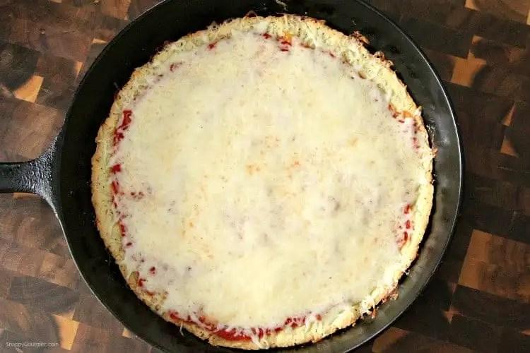 Almond Flour Pizza Crust in cast iron pan