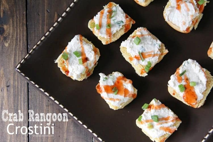 crab rangoon crostini on brown platter