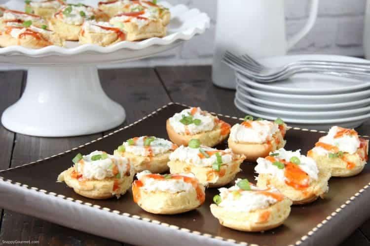 Crab Rangoon Crostini on brown serving platter on table