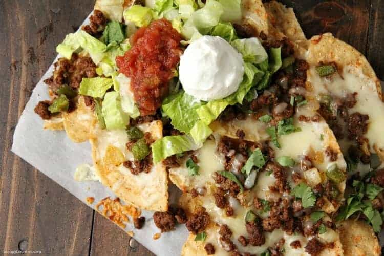 Loaded Nachos with sour cream, salsa, and lettuce