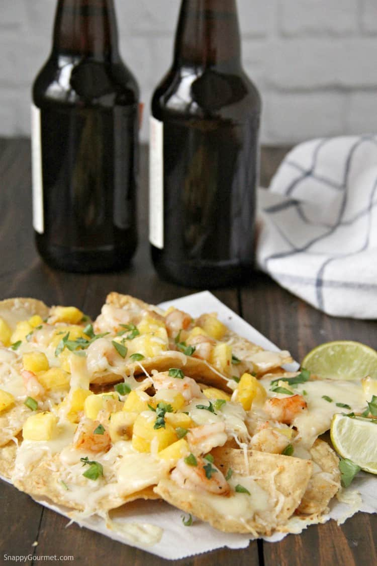 Shrimp Nachos with beer bottles