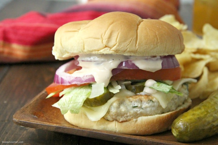 Dill Pickle Chicken Burger on wood plate