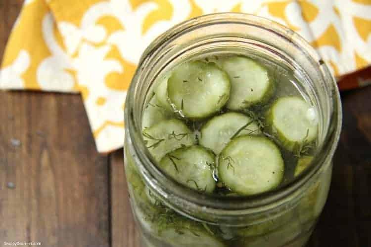 sliced dill pickles in mason jar