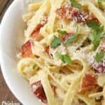 Chicken Bacon Alfredo Pasta with Parmesan cheese and parsley in bowl