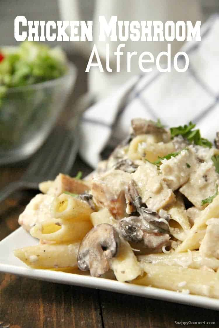 Chicken Mushroom Alfredo Pasta on plate with salad