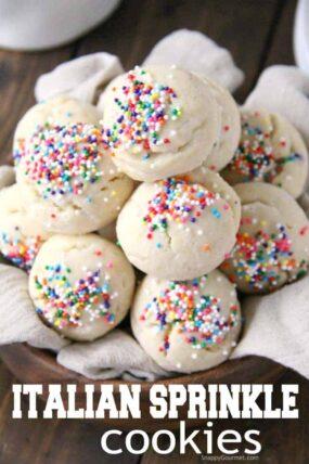 Sprinkle cookies stacked in wood bowl