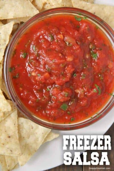 freezer salsa made with canned tomatoes in bowl on plate with tortilla chips