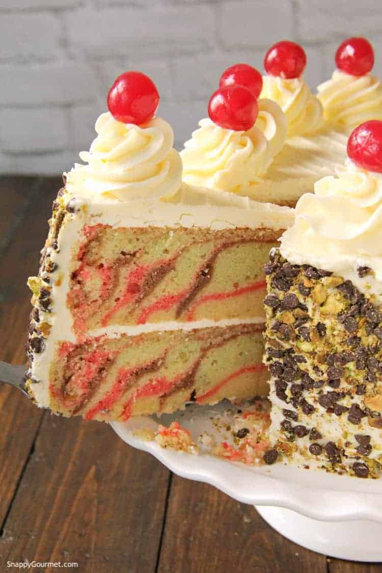 slice of spumoni cake being removed from cake