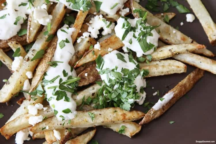 Greek french fries with feta cheese and other toppings