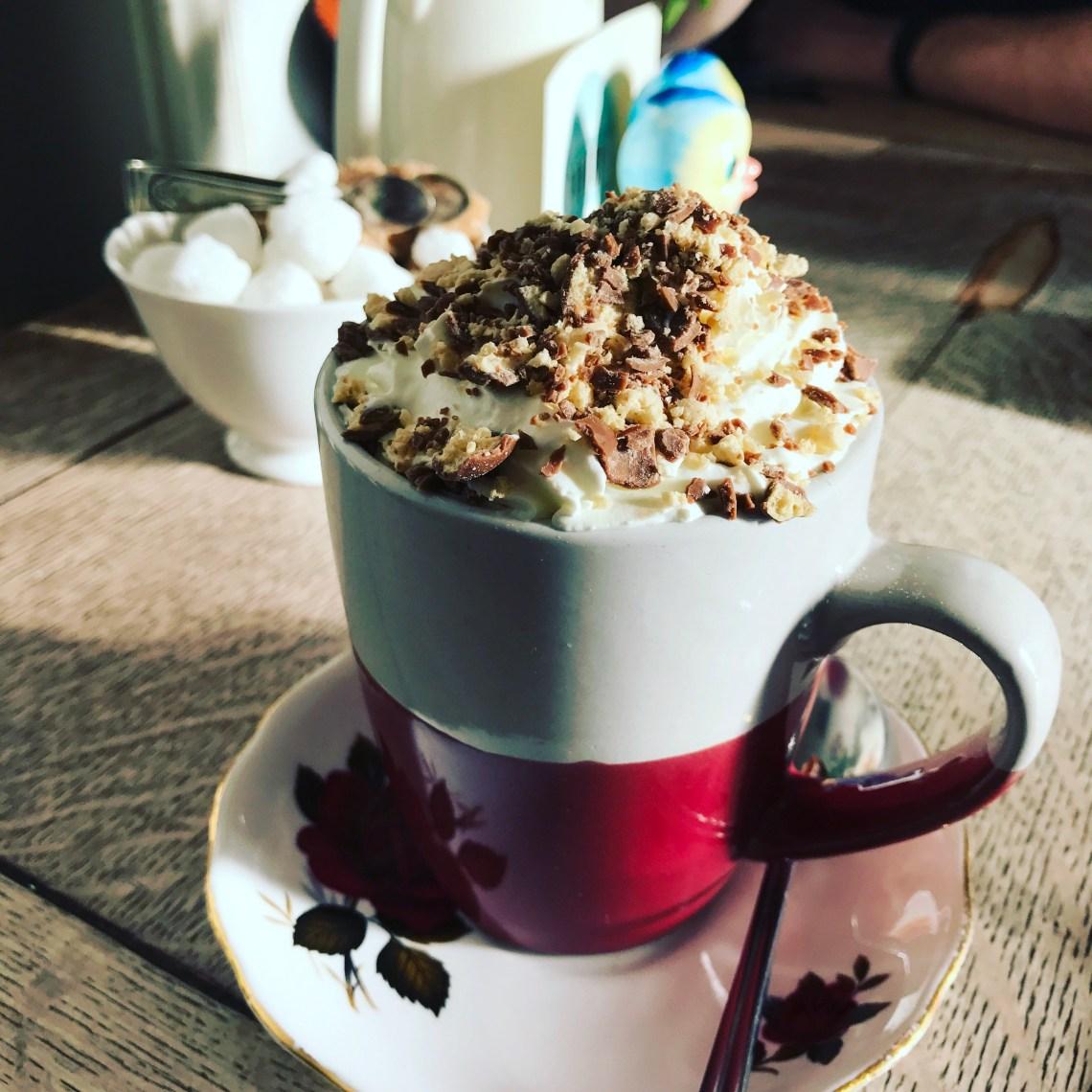 Hot chocolate crushed maltesers whipped cream