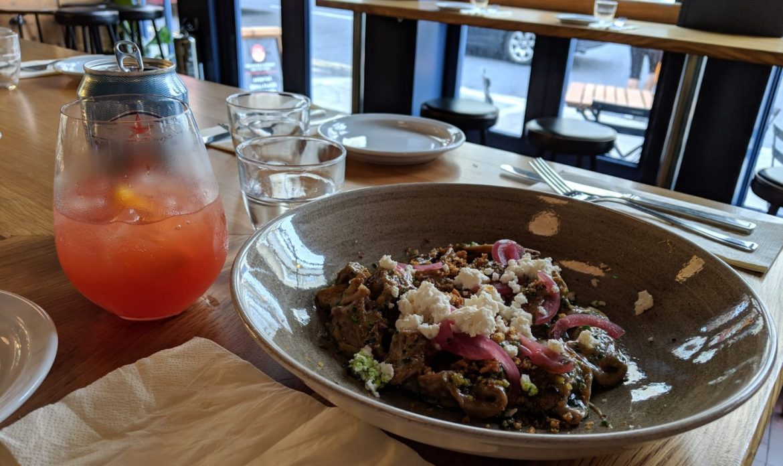 bowl of pasta with orange drink in background, cincin hove
