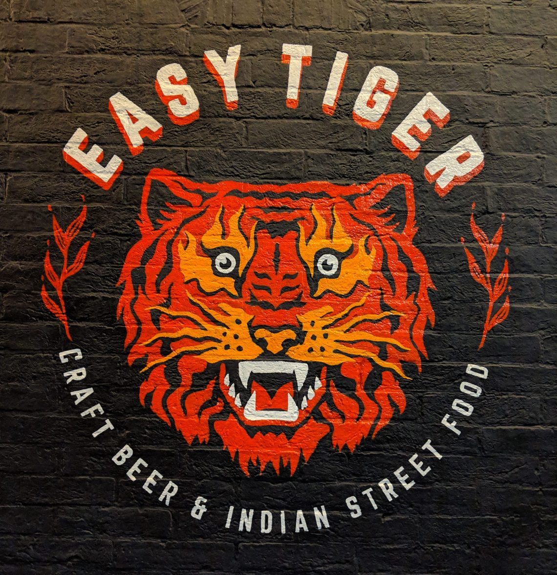 easy tiger at the hampton close up of logo outside on building