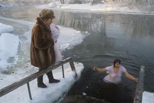 Russian woman swimming in winter