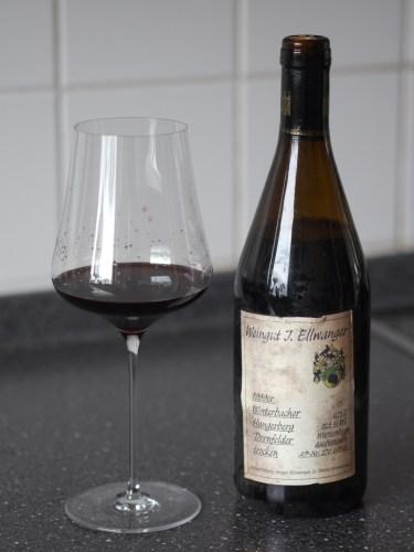 A bottle of Winterbacher Hungerberg Dornfelder Trocken 1999 from Weingut Jürgen Ellwanger with glass sample