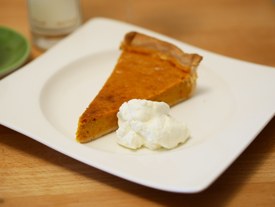 A slice of Pumpkin Pie with whipping cream