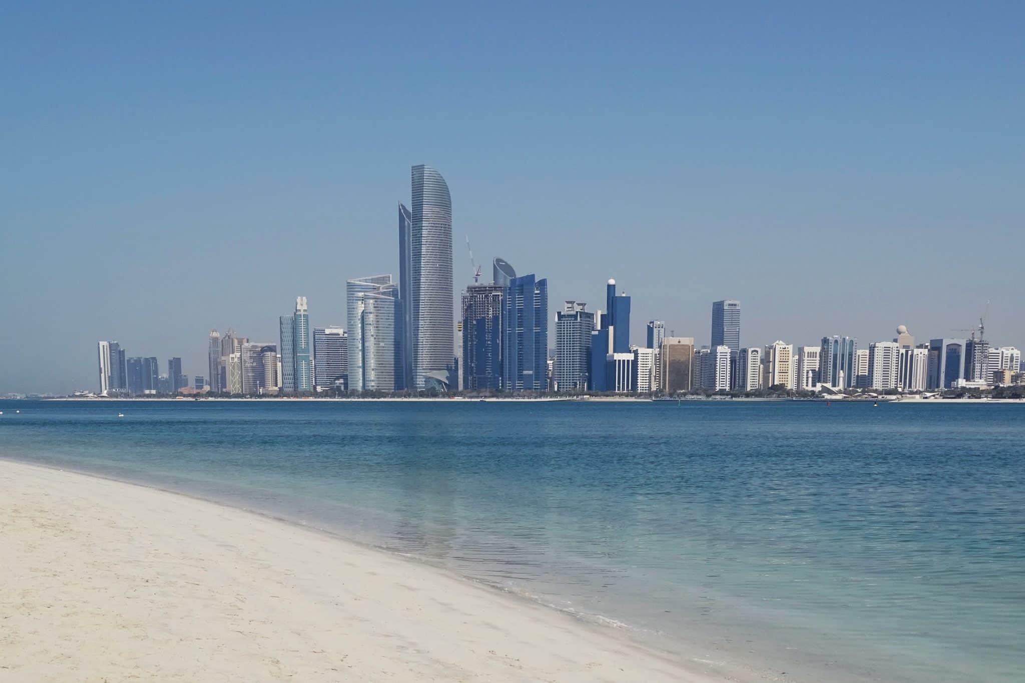 Abu Dhabi beach and city skyline