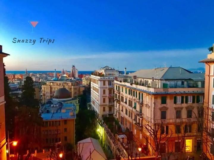 City buildings at dusk with blue sky