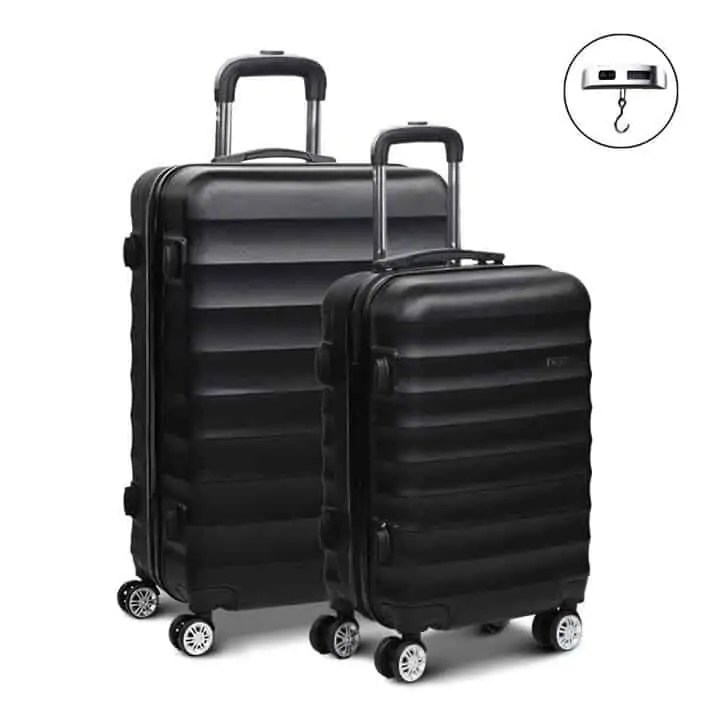 2 black suitcases Snazzy Trips