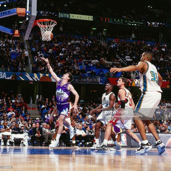John Stockton #12 of the Western Conference shotos against Grant Hill #33 of the Eastern Conference during the 1997 All-Star Game on February 9, 1997 at Gund Arena in Cleveland, Ohio.
