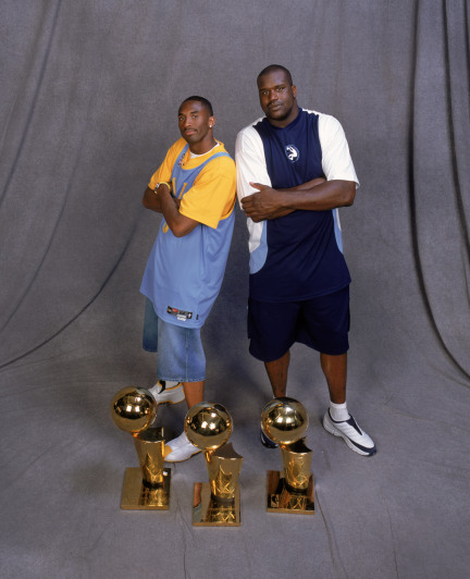 LOS ANGELES - JUNE 14: Guard Kobe Bryant #8 and center Shaquille O'Neal #34 of the Los Angeles Lakers pose for a studio portrait with their three championship trophies during the Lakers championship victory celebration in Los Angeles, California on June 14, 2002. The Lakers swept the New Jersey Nets in four games. NOTE TO USER: User expressly acknowledges and agrees that, by downloading and/or using this Photograph, User is consenting to the terms and conditions of the Getty Images License Agreement Mandatory Copyright Notice: Copyright 2002 NBAE (Photo by Andrew D. Bernstein/NBAE/Getty Images)