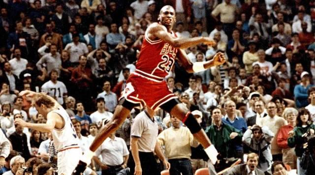 Michael Jordan in the Air Jordan 4 Black/Red/Cement