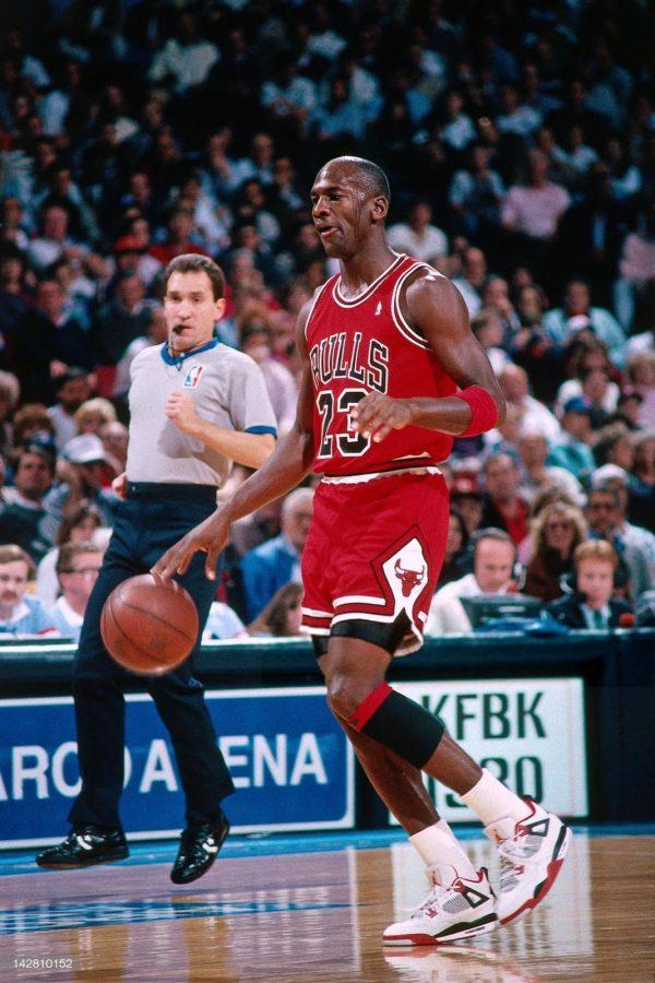 Michael Jordan in the original Fire Red Air Jordan 4 in 1989
