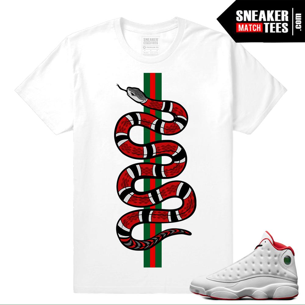 19b490066ca Jordan Retro 13 – History of Flight T shirt – Designer Snake – White