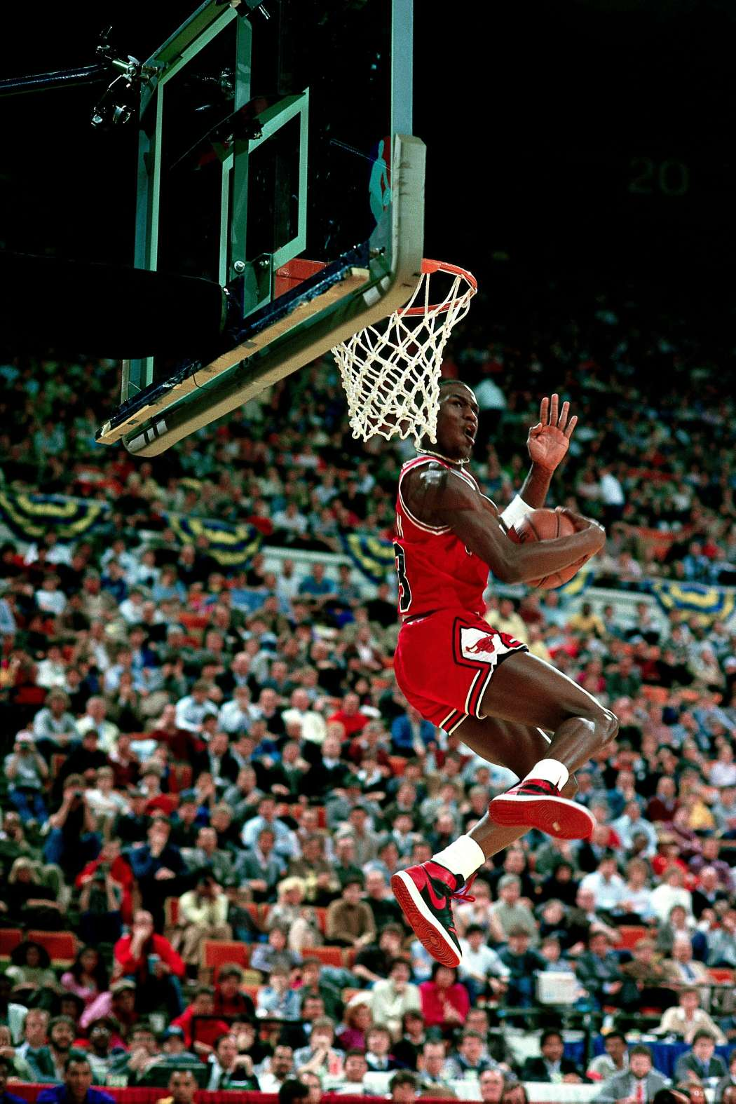INDIANAPOLIS - FEBRUARY 10: Michael Jordan #23 of the Chicago Bulls goes for a dunk during the 1985 NBA All Star Slam Dunk Competition at the Hoosier Dome on February 10, 1985 in Indianapolis, Indiana. NOTE TO USER: User expressly acknowledges and agrees that, by downloading and/or using this Photograph, User is consenting to the terms and conditions of the Getty Images License Agreement. Mandatory copyright notice: Copyright NBAE 1985 (Photo by Andrew D. Bernstein/NBAE via Getty Images)