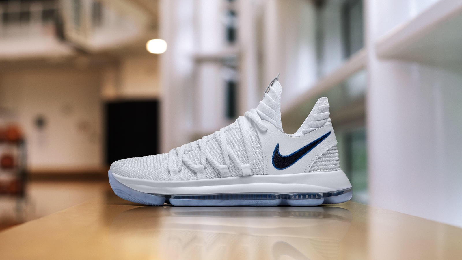 Although this KD10 may seem simple with its white upper only being broken  up by a black lateral Swoosh bordered in royal blue , its white midsole and  ...