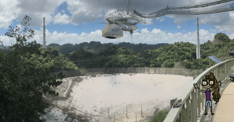 A photo of the Arecibo Telescope, from the observation platform. So, a lot of trees surrounding a huge dish in the ground. An apparatus is suspended above it -- also huge.  Dollissa, looking smaller than ever, is drawn and superimposed on the image. She looks excited and very thin.